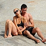 Paris Hilton's new man wrapped his arms around her during a romantic afternoon together.