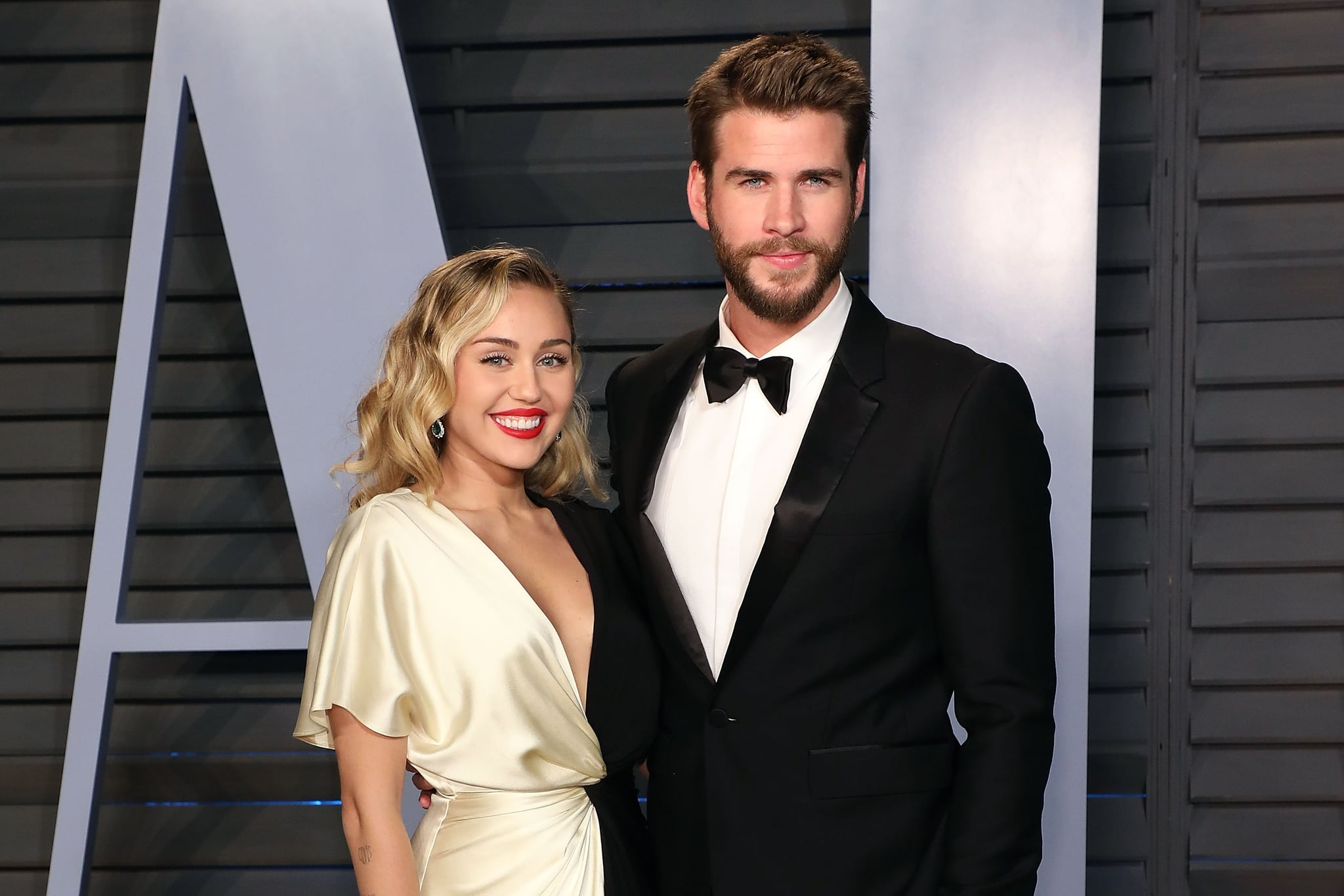 BEVERLY HILLS, CA - MARCH 04:  Miley Cyrus and Liam Hemsworth attend the 2018 Vanity Fair Oscar Party hosted by Radhika Jones at the Wallis Annenberg Centre for the Performing Arts on March 4, 2018 in Beverly Hills, California.  (Photo by Taylor Hill/FilmMagic)
