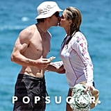 Julia Roberts smooched Danny Moder during a day at the beach in Kauai with their kids in August 2012.