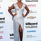 Kelly Rowland dazzled while posing in her Rami Al Ali metallic gown and coordinating silver ankle-strap sandals.