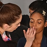 """It's pretty grunge,"" lead makeup artist Romy Soleimani said. ""The collection had futuristic and sporty elements. We used the gloss on the cheeks and on the eyelid, so it's a little bit sweaty but also reflective."" Her primary product was MAC Clear Lipglass and a bit of Haute and Naughty mascara. """