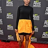 Kerry Washington posed in a Michael Kors high-low gown with a neon orange taffeta skirt, a matching clutch, Rogier Vivier pumps, Vhernier earrings, and a Jennifer Fisher ring at the MTV Movie Awards.