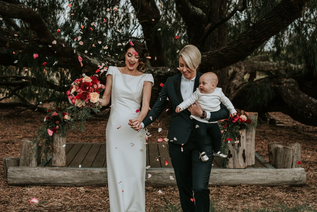"Lauren and Stacey said ""I do"" while surrounded by their family, friends, and infant daughter in a gorgeous ceremony at the Silversprings Cottages in Australia. See the wedding here!"