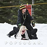 Gwen Stefani's son Kingston got on her back to sled down a hill in the snow.