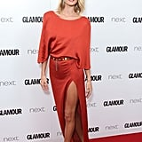 Rosie accessorised her metallic Cushnie et Ochs dress with a gold belt and matching sandals at Glamour's Women of the Year Awards in London.