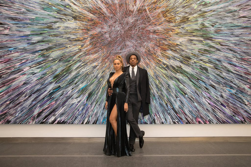 "Beyoncé and JAY-Z were dressed to the nines for the annual Roc Nation in NYC on Saturday. The singer shared a couple of snaps of them posing in front of a mural and descending a staircase in style; Beyoncé showed off her curves in a low-cut, high-slit black dress, while JAY went for a vest and hat. Inside the event — which is thrown by JAY's entertainment company — JAY mingled with rappers like Diddy, T.I., Fat Joe, and Big Sean, while Beyoncé met up with Mariah Carey. Also in attendance were Nick Jonas, Monica, Cassie, and model Winnie Harlow. Later in the evening, Beyoncé and JAY did a costume change for Clive Davis's annual pre-Grammys party, during which JAY was honored with the Grammys salute for his decades-long music career. While on stage, Clive even referred to Beyoncé as ""the first lady of music,"" and the crowd gave her a standing ovation. The couple is also heading to the Grammys on Sunday night — 4:44, JAY's auditory response to his wife's Lemonade, is nominated for eight awards. Keep reading to see Bey and JAY's glamorous day out, then check out the best photos from their many years together.      Related:                                                                                                           JAY-Z's Clever Clapback to Trump's ""Sh*thole"" Comment Deserves an Award"