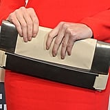 Paz Vega carried a metallic-and-beige colorblocked clutch.
