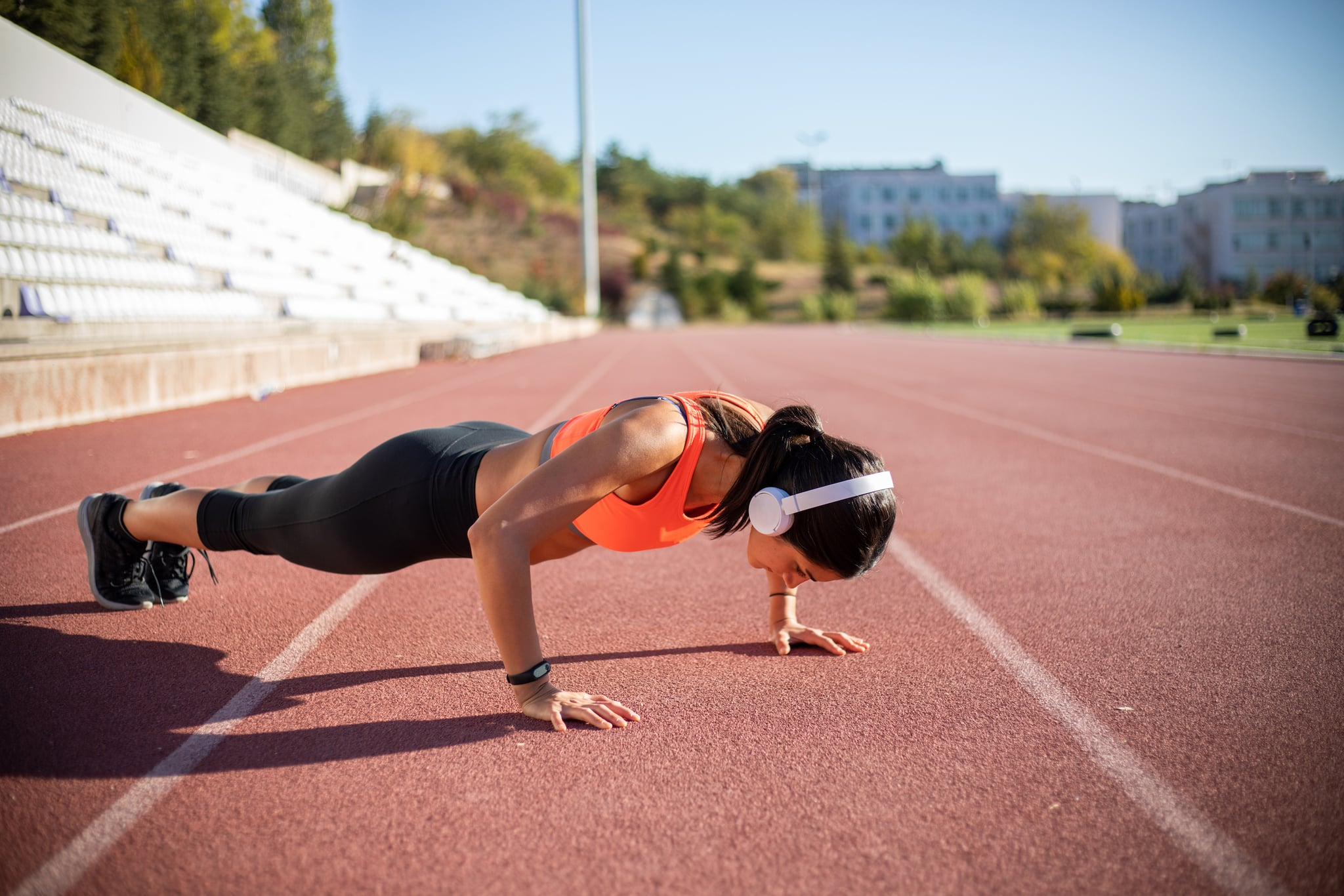 Athletic woman exercising push-ups