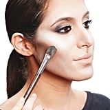 To intensify the contour, place dark powder over the brown paint. You can also add white eye shadow over the highlighted areas.