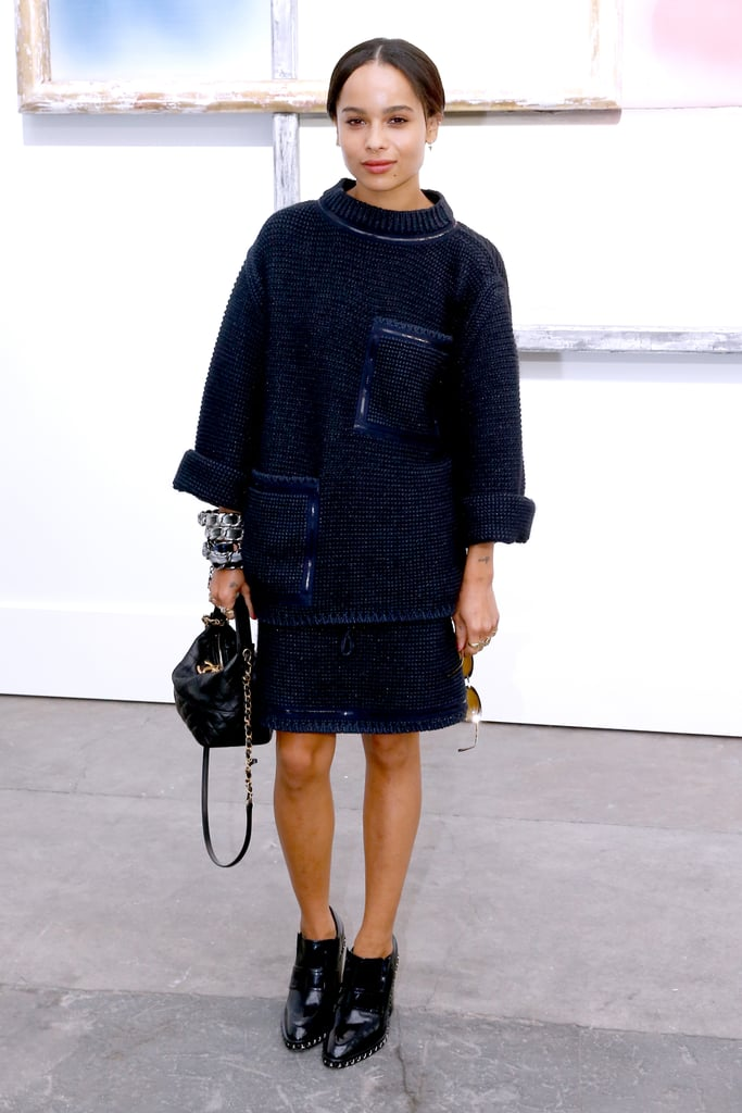 Zoë Kravitz dialed back her eclectic style in lieu of something more sophisticated at the Chanel show. It was all about the accessories for Zoe's look.