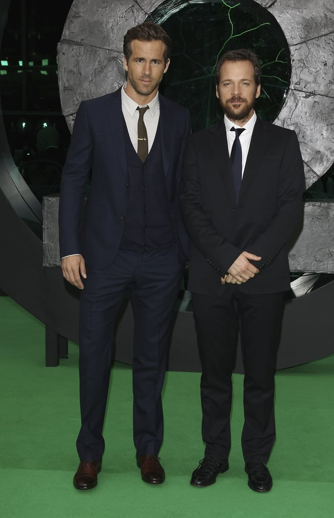 Ryan Reynolds and Peter Sarsgaard kept their European Green Lantern trip going today at the Berlin premiere of the movie. The onscreen nemeses threw their arms around each other to pose for pictures and cracked each other up on the green carpet as they debuted the superhero film in Germany. Peter's promotional duties prevented him from joining his wife Maggie Gyllenhaal at her father, Stephen Gyllenhaal's, wedding this weekend in Oahu. Instead, Peter and Ryan are globetrotting, as their 3D film enjoys an international rollout, kicking things off with a stop in Spain last week. Green Lantern hit theaters in America on June 17, and while it took the top spot at the box office its first weekend, it didn't perform quite as well as some of this Summer's other big action features like Thor and current number one Captain America.