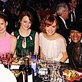 Jessica Chastain, Emma Stone, Ahna O'Reilly, and Cicely Tyson of The Help pose at their table.
