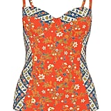 If you want a one-piece that gives you a slimming effect as well, opt for this paneled Tory Burch Batik Floral-Print Underwired Swimsuit  ($250).