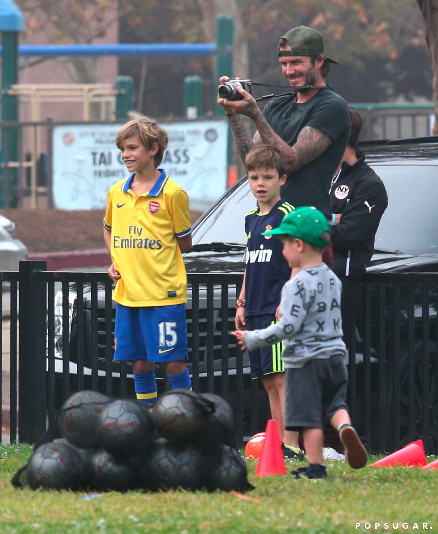David Beckham and his boys watched Harper score a soccer goal.