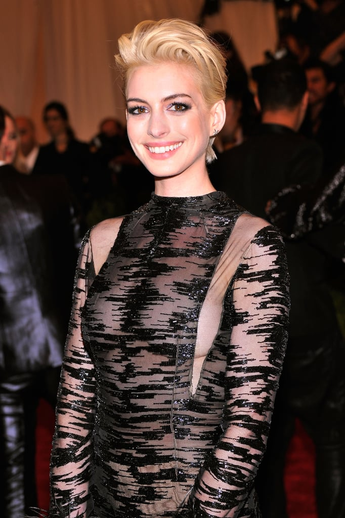 Anne Hathaway debuted a peroxide-blond hair colour that shocked us all at this year's Met Gala. The actress said that Debbie Harry inspired her punk transformation for the night.