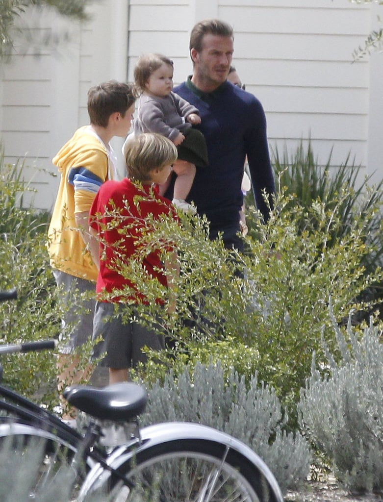 David Beckham held Harper with the boys in tow on Easter Sunday.