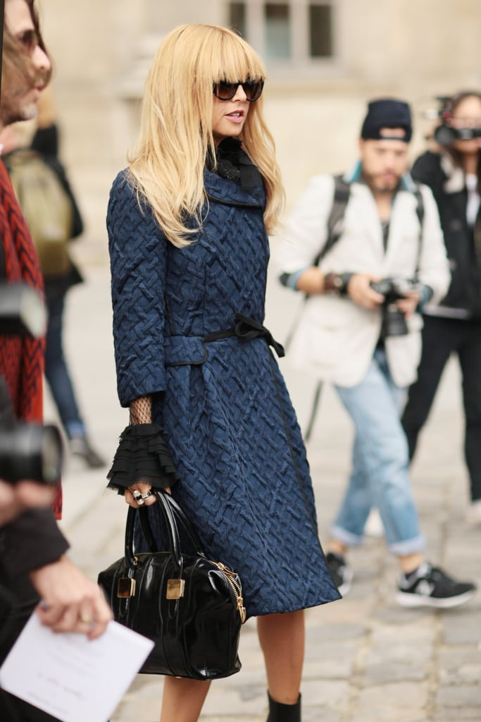 Rachel Zoe was ultrachic in a textured navy coat and dramatic ladylike sleeves peeking out from underneath.