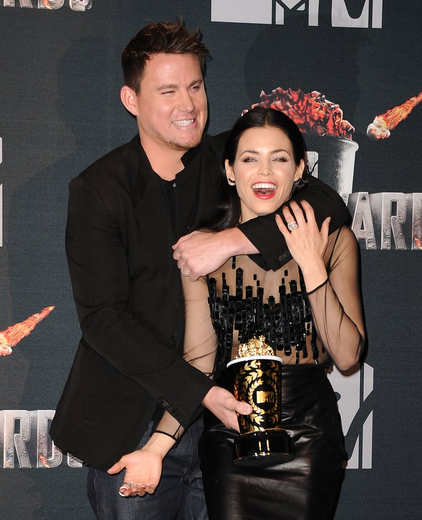 They shared a playful moment with Channing's MTV Movie Award statue backstage during the event in April 2014.