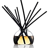 """I always give away Voluspa candles every year. This season, I'm switching things up with the diffuser option. I love the chic glass vase and crisp champagne scent."" — Chi Diem Chau, associate editor  Voluspa Maison Noir ""Crisp Champagne"" Mini Diffuser ($35)"