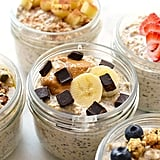 Overnight oatmeal jars topped with fruit, nuts, and chocolate