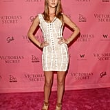 The model wore an Herve Leger bandage dress on the pink carpet at a Victoria's Secret event in 2010.