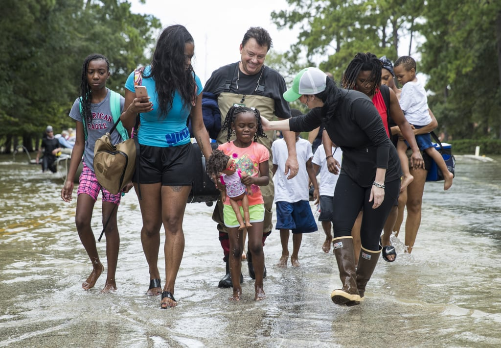 The Walker and Brown families leave their homes near west Houston, TX.