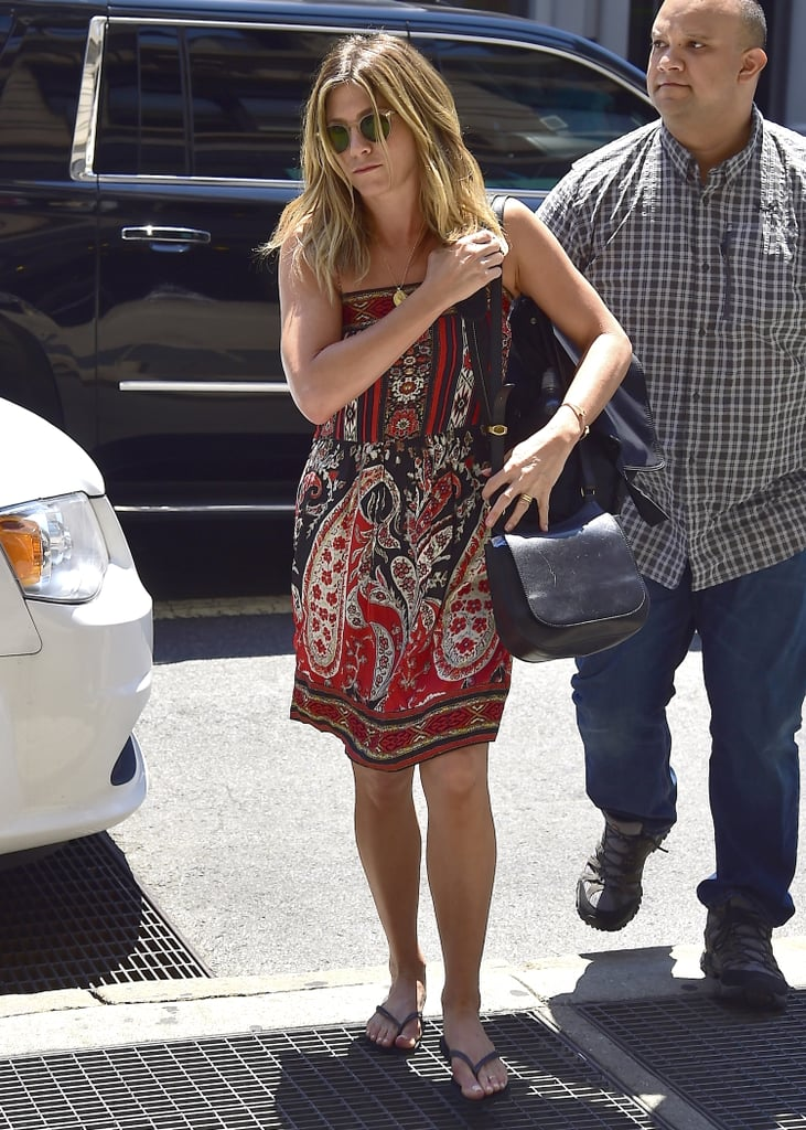 Jen's The Row bag was the perfect neutral outfit accoutrement to a busy paisley-print sundress in Soho in June 2016.