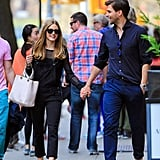 Olivia styled her black Paige Denim overalls with a pair of embroidered flats, a chic Dior bag, and a long-sleeved sheer top.
