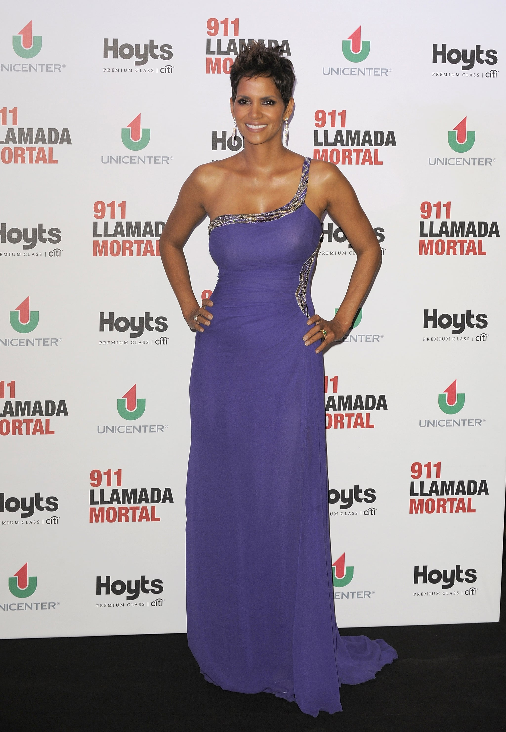 Promoting The Call, Halle looked red carpet fabulous in a perfectly fitting purple gown.