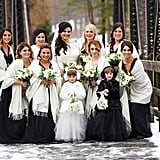 These bridesmaids' black dresses were topped with white shawls at this snowy wedding.