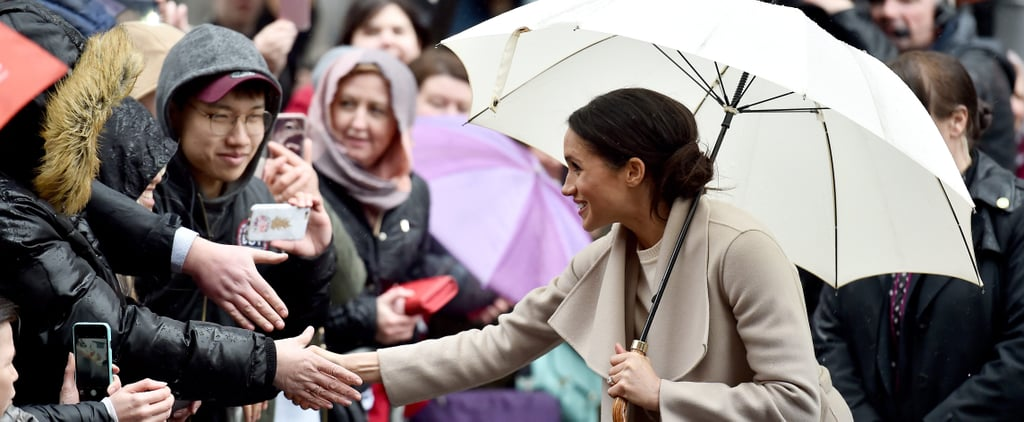 Meghan Markle, the Sweetest Human, Runs Through the Rain in Heels to Greet a Young Girl
