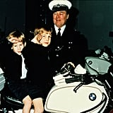 Prince William and Prince Harry sat atop a police motorbike in November 1987 in Windsor, England.