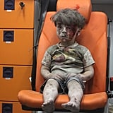 August 17: Wounded Syrian child Omran Daqneesh sits in an ambulance after air strikes on his Aleppo neighbourhood.