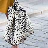 Give your mom something a little bit funkier (without going overboard). This Emerson Fry leopard linen shopper ($218) is the perfect way to introduce exotic print and a classic silhouette into her accessory lineup.