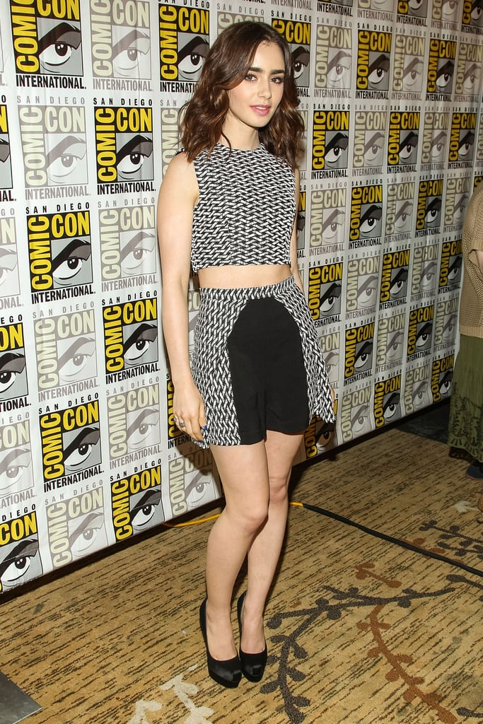 Lily Collins wore a top and shorts by Paper London, a pair of Brian Atwood shoes, and an H.Stern ring to a press event for The Mortal Instruments: City of Bones.