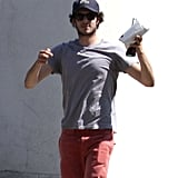 Adam Brody kept a low profile in a dark hat and shades.