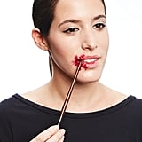 Apply the thick blood mixture using the end of your makeup brush, which is easier to wipe clean than the bristles.