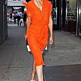 Katie Holmes wore a bright orange dress out in NYC.
