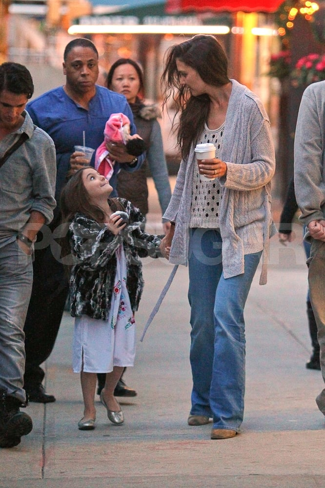 Katie Holmes held hands with her 6-year-old daughter Suri Cruise last night in NYC. The girls went for a late evening stroll together and capped off a fun day by getting a cupcake for Suri and coffee for Katie. Suri's had her fair share of treats this month, since Katie and her husband Tom Cruise recently celebrated the little one's birthday. Suri Cruise turned 6 two weeks ago, and we celebrated her milestone by looking back at all the jet-setting she's done in such a short time. Katie has been side by side with Suri for the past couple months while Tom works on Oblivion in Louisiana. There are new rumors that Tom Cruise will make Top Gun 2 next, and Katie's had reports of another sort of endeavor. Katie's reps shot down recent stories that she and Tom are expecting a little sister or brother for Suri.