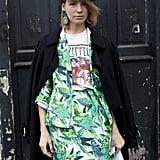 Russian designer Vika Gazinskaya accessorized her otherwise-girlie getup with an old-school Nike cap during Paris Fashion Week.