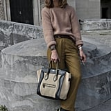 We love the mix of cozy knit and tweedy trousers — but we're most drawn to her gorgeous Céline tote.