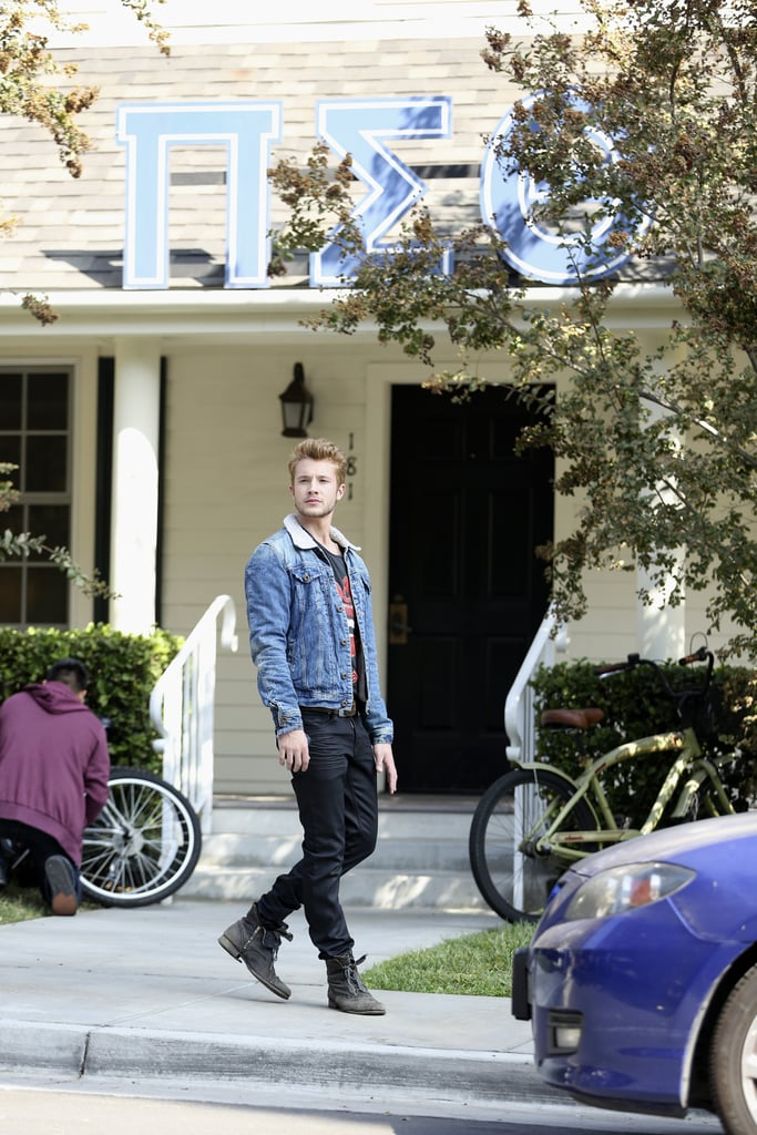 Roux's character stands outside what looks like a fraternity house. Source: ABC Family