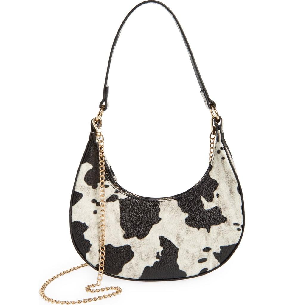 A Bag With a Fun Print: Malibu Skye Dara Cow Print Mini Crescent Shoulder Bag