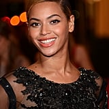 Beyoncé chose minimal makeup and a slicked-back hairstyle to show off the intricate beadwork on the neckline.