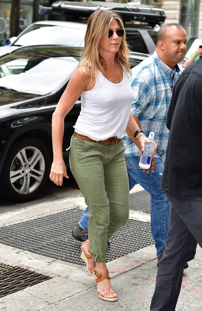 She's Paired a White Tank With Olive-Green Pants