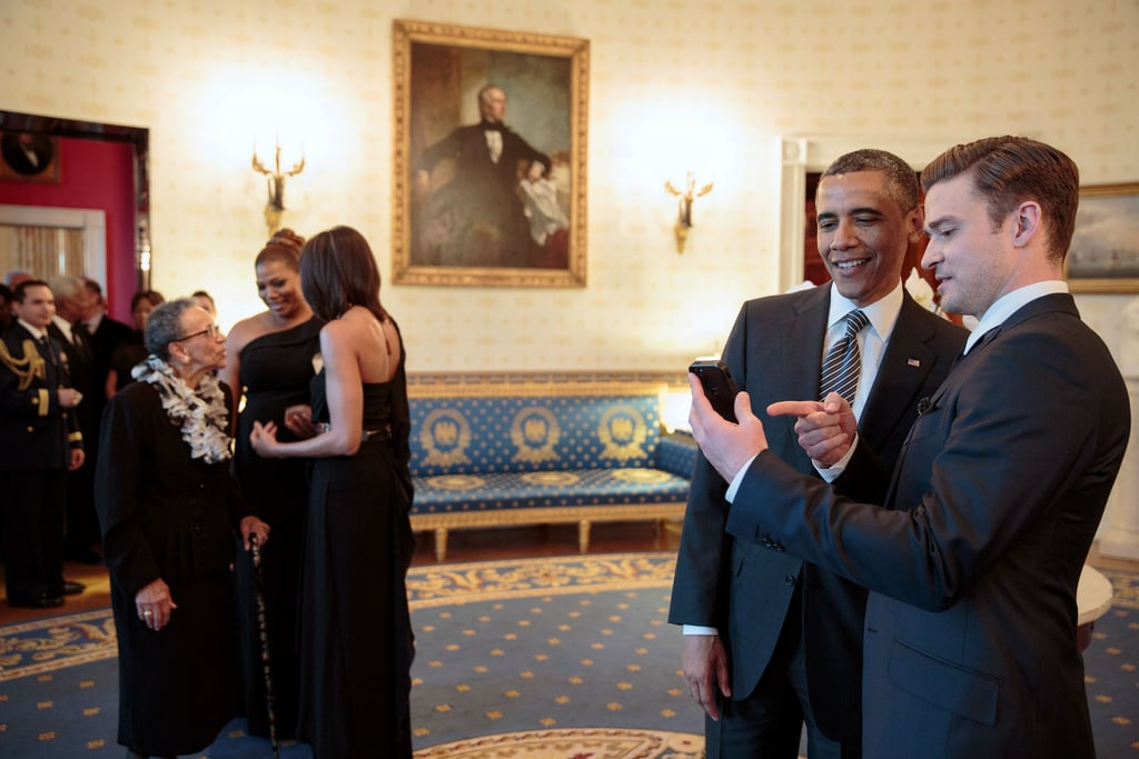 Justin Timberlake shared something with President Obama on his phone while visiting the White House in April 2013. Source: Flickr user The White House