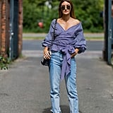 With a sweet wrap-blouse and ballet flats