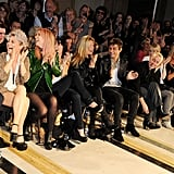 Kate Moss and husband Jamie Hince check out designer James Small's London Fashion Week Show.