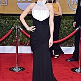 January Jones's black matte wrap gown draped with white organza by Prabal Gurung proved black and white is anything but boring.
