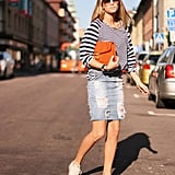 Go for classic Summer style in a denim skirt, nautical stripes, and your trusty Chucks. Photo courtesy of Lookbook.nu